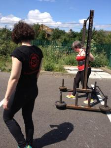 Walking with a 80kg yoke. Photo (c) Strength Ambassadors